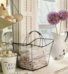 enamel jug, wire basket of kitchen linens, pail of 'fresh eggs'