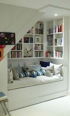 Home Organizing Ideas -- Under-Stair Bookshelves and Seating Area..ours would be lower to the ground ...smaller space than this.