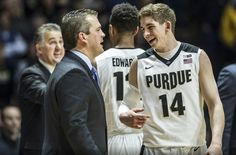 Ryan Cline, Freshman on Purdue Basketball team #14, laughs with a coach during a game in 2016 #boilerup