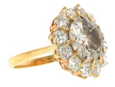 Antique Diamond Cluster Ring, Old Euro 4.00ct::centering an Old European cut diamond weighing 4.00ct., (Natural Fancy Yellowish Brown), framed by twelve Old Mine cut diamonds weighing app. 2.25ctw., fashioned in 14k. Antique diamond top (c.1900) with later shank. Size 6.25GIA 2155155231