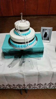 Cake sitting on a wrapped shoe box