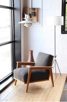 French oak lounce chair c.1950s with new upholstery. PH5 pendant light by Louis Poulsen and French standard lamp now at our Brunswick warehouse.