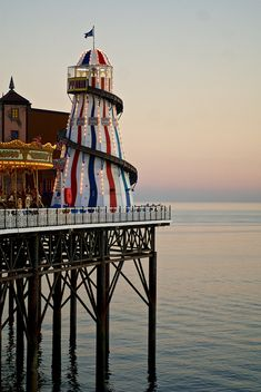 The Brighton Marine Palace and Pier is a pleasure pier in Brighton, England.  Go to www.YourTravelVideos.com or just click on photo for home videos and much more on sites like this.