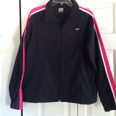 Nike jacket. Nike zip up with pockets. Black with pink and white stripes. Nike Tops Sweatshirts & Hoodies