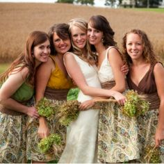 A rustic, farm wedding in the middle of a cornfield! (Everything was handmade or repurposed including the bride & bridesmaids dresses!)