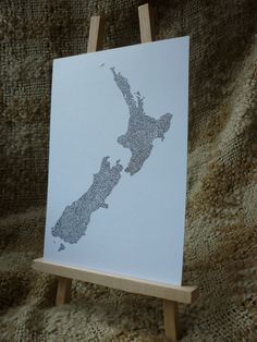 Ornate New Zealand map, filled with filigree, birds and lizards - print