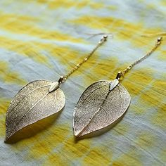 These boho earrings have beautiful, gold-color dipped dangling leaves. These versatile earrings go great from day to night, from the office to the beach! 5.5 inches long.