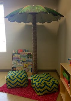 My Kinder reading area! Took a carpet roll from Lowes (just ask for one laying around) and covered it in lunch bags. The umbrella came from Wal-Mart. My $18 tree :)