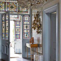 leaded glass doorway. beautiful. notice the double entryways.