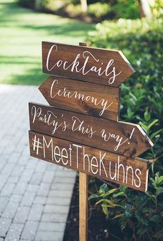 Direct your guests to the next stop of the party with a welcome sign including your hashtag | Brides.com