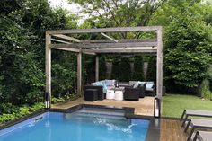 Pool Craft designed and built a modern frame to extend the outdoor living space next to the pool. #retractableshade #outdoorliving #retractableawning #retractablecanopy #backyardpatio #retractablepergola #sunprotection #outdoorstructures #backyardretreat #rainprotection #waterproofcanopy #backyardrenovations #poolsideshade #curbappeal #waterproof #backyardinspiration #pergoladesign #landscapedesign Retractable Shade, Retractable Pergola, Modern Pergola, Modern Backyard, Backyard Retreat, Backyard Patio, Outdoor Spaces, Outdoor Living, Outdoor Decor