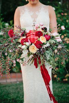 lush red fall bouquet, photo by Megan Welker Photography, flowers by Siren Floral Co http://ruffledblog.com/garden-romance-wedding-inspiration #weddingbouquet #flowers