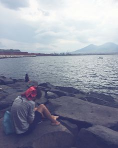 Reading on the cliffs below the city of Naples with Vesuvius in sight.