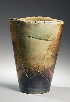 ŌTANI SHIRŌ (b. 1936) Tall flaring, ash-glazed flower vessel with incised designs and brown to green banded coloration, 2010 Stoneware with ...