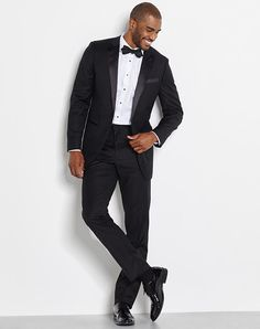A slim peaked lapel, diamond bowtie and patent leather shoes will make you feel as if you were dressed by a stylist | The Black Tux | https://www.theknot.com/fashion/the-davis-outfit-the-black-tux-tuxedo