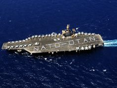 "MEDITERRANEAN SEA (July 8, 2009) Sailors assigned to the Eisenhower Carrier Strike Group form on the flight deck of the aircraft carrier USS Dwight D. Eisenhower (CVN 69) to spell out ""NATO-OTAN"". Description from commons.wikimedia.org. I searched for this on bing.com/images"