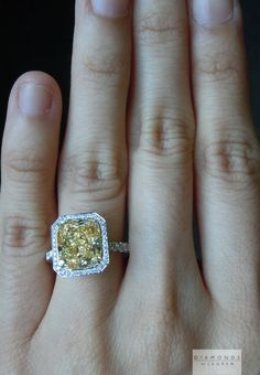 5.01ct Light Yellow Cushion Cut diamond ring