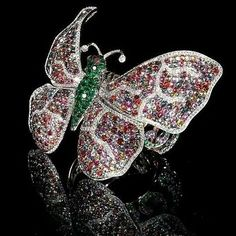 Butterfly cuff bracelet made of multicolored sapphires, diamonds and emeralds by deGrisogono.