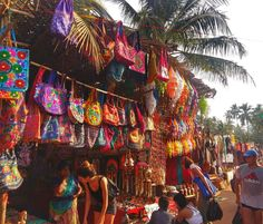 Shopping and haggling for bargains at the Anjuna Flea Market in Goa, India