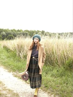 fullness that looks good with chunky fall shoes  #highlands_style #winter_style  Wool plaid is left unfinished at the hem to give this skirt a rugged look. The peasant style has a narrow waistband, hip pockets, and fullness that looks good with chunky fall shoes.