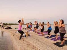 Beach yoga at Belize with Yoga Peach.