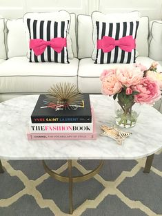 Marble oval coffee table, Fashion books, peonies and striped bow pillow Home Decor Sites, Diy Home Decor, Room Decor, Hipster Home, Bow Pillows, Peony Arrangement, Stylish Petite, White Sofas, Coffee Table Books