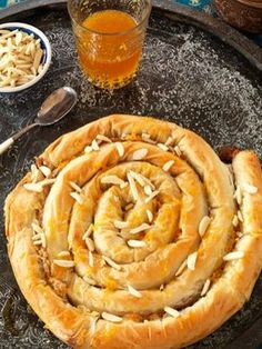 Almond-filled Filo Snake (M'hancha)- keen to try this as I ♥ baklava