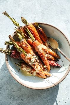 This whole roasted carrots recipe is topped with an addictive paleo sesame ginger dressing. It's a great quick side dish that's also gluten-free + healthy!
