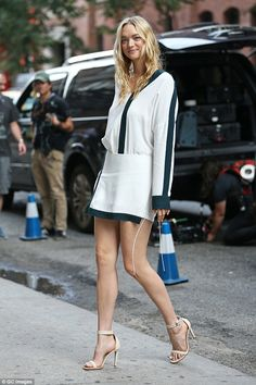 Legs eleven... out of ten! Gemma Ward shows off her long legs in a white mini dress with green detailing as she struts into theDion Lee Fashion Show on Saturday in New York City