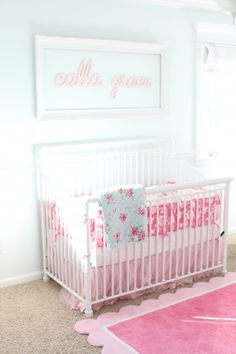 """Cursive name above the crib with empty frame;    Paint color: """"Bashful"""" by Valspar"""