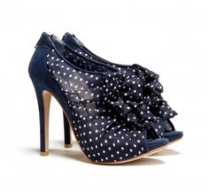 Back zipper polkadot bootie with ruffles and an open toe. The hidden platform and rubber sole add extra comfort. Adorable!