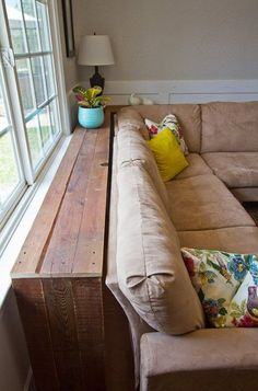 """Here's an interesting answer to """"What do we do with the couch?"""" Pinned from OUR House. Maybe just put the couch table there, under the window. No, the couch table would be too low. So set it on something to make it higher."""