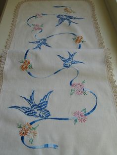 Lovely vintage tablerunner, linen - embroidered birds in blue, crocheted border <> (bird decor, motif)  http://www.etsy.com/listing/81522563/table-runner-vintage-1940s-embroidered?ref=sr_gallery_9&sref=&ga_search_submit=&ga_search_query=lace+table+cloths&ga_view_type=gallery&ga_ship_to=US&ga_page=4&ga_search_type=all&ga_facet=