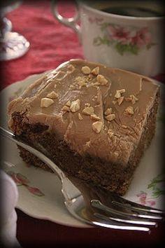 8 MILKY WAY candy bars 1 stick butter 2 c. sugar 4 eggs 1 tsp. vanilla 1/2 c. chopped nuts 1/2 tsp. soda 1 c. buttermilk 2 1/2 c. cake flou...