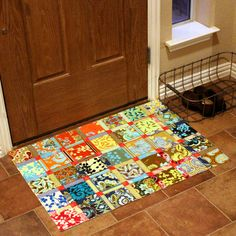 """""""My ingredients? 2.5 bottles of Mod Podge to glue my 3 layers of fabric together and a fantastic new find: rug backing. Rug backing is painted on to the bottom to keep the floorcloth from sliding around. I can see all kinds of uses for this."""""""