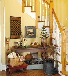 Enhance your entryway with dynamic pieces, such as a game board, a cluster of different lanterns or even an old seat repurposed as a perch for a horse figurine.