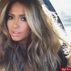 Not only is her hair color amazing but she looks just like JLo