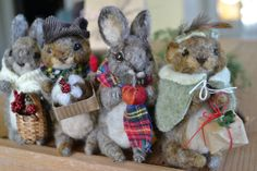 These festive little squirrels and rabbits are one-of-a-kind, meaning only one of each is available. Each one has been needle felted and dressed by