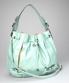 With this chic companion in tow, the city streets feel like a high-fashion runway. Sleek faux leather molds this hobo bag with hints of contrasting colors and an adjustable drawstring to loosen or tighten, while the detachable drawstring helps out during those hands-free moments.10.5'' W x 13'' H x 5'' D...