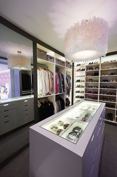 So fab walk in closet! Diane Bergeron Interiors - closets - walk in closet, closet island, closet chandelier