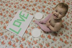 Spell words with painters tape and have baby finger paint. Once it dries remove the tape! Cute!