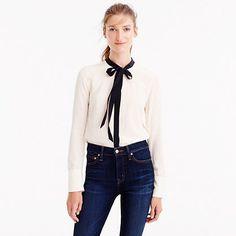"""This pretty silk top features a feminine necktie that's perfect for work and after-hours. <ul><li>Body length: 26 1/2"""".</li><li>Silk.</li><li>Long roll-up sleeves.</li><li>Functional buttons at cuffs.</li><li>Hidden front placket.</li><li>Dry clean.</li><li>Import.</li></ul>"""