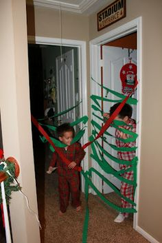 Wrap the doors to the kids room on Christmas Eve so they have to run through it on Christmas morning. Too cute!! I will be doing this!