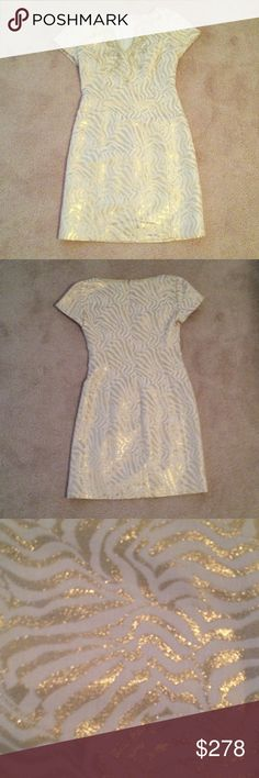 Lilly Pulitzer Gold/Cream Dress Beautiful metallic freckled gold and cream dress! Bought it from another posher, but unfortunately was too tight around the chest. I wish I could find this in a zero! Im totally up for negotiating reasonable offers and bundles. As you can see it's absolutely a stunning piece! My loss is your gain! There are no damages seen therefore the price reflects the condition of the dress. Lilly Pulitzer Dresses Mini