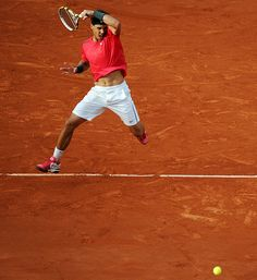 Rafael Nadal hits one of his signature powerful forehands against Juan Monaco at the French Open. Nadal only dropped two games in an easy straight set victory.    Read more: http://sportsillustrated.cnn.com/multimedia/photo_gallery/1206/leading-off-061112/content.5.html#ixzz1xhS0NB1r