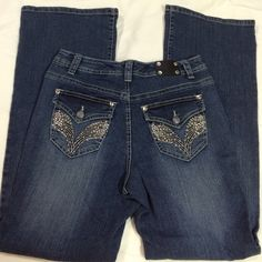 """Bling pocket jeans Bling 5 pocket jeans size 6. Approx measurements flat: inseam 31"""", waist 15.5"""" flat, rise crotch to waist in front 9.5"""". Materials listed in photo. NWOT. Please ask any questions prior to purchasing. Thank you! Premium Jeans Jeans"""