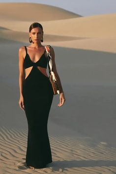The Cult Gaia Serita is a cutout woven knit maxi dress. Thoughtful cutouts shape your figure, highlighting the small of your waist. A bra silhouette with a bare all open back. Pair with the Banu Bag and bare feet and you're ready for a night of dancing on the beach. This dress is worth all the Instagram hype! | Designer Dress | Knit Maxi Dress | Cutout Maxi Dress | Resort Dress | Resort Outfit | Wedding Guest Dress | Sexy Maxi Dress | Designer Summer Outfit | Oscar Party Dress | LBD Cruise Dress, Cruise Outfits, Wedding Rehearsal Dress, Beach Dresses, Summer Dresses, Brunch Dress, Color Pants, Resort Dresses, Date Night Dresses
