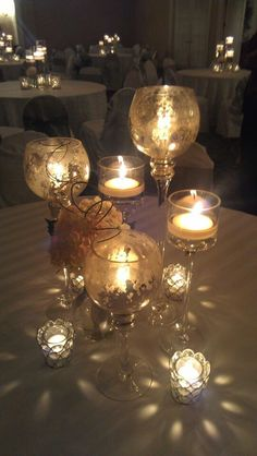 Looks like mercury glass which I love! Pretty centerpieces