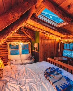 Cozy cabin bedroom with a skylight for stargazing.