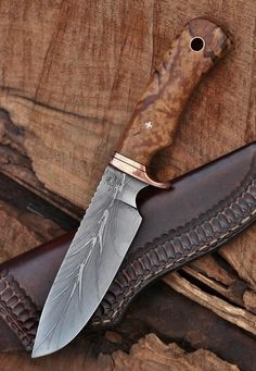 Custom hunter/camp knife, 5 inch blade, recycled from lumber mill saw steel.